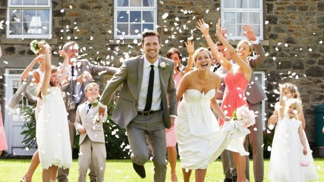 Guests-Throwing-Confetti-Over-Bride-And-Groom-cm
